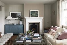 Bright and breezy sitting room with 2 large upholstered sofas, 2 stools and a glass coffee table facing the white mantel piece and wood burner Home And Living, Interior Design, House Interior, Home Living Room, White Fireplace, Home, Beach House Interior, Interior, Family Room
