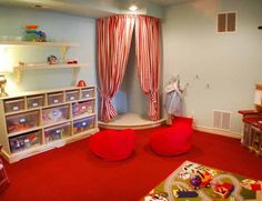playroom ideas. I love the stage with the curtains!