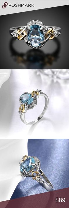 THE NEW ABSOLUTELY BLUE TOPAZ ABSOLUTELY BLUE TOPAZ IS STUNNING! THE SURROUNDING AAA CLEAR CZ COMPLIMENT THE OVAL CUT TOPAZ THIS BEAUTY IS SET IN PLATINUM OVER BRASS WITH 14K YELLOW GOLD ACCENTS SHAPED IN A TWIST OF HEARTS AMAZING RIGHT? THE TOPAZ MEASURES APPROX 7MM X 8MM includes black velvet gift box Jewelry Rings