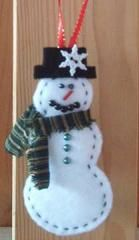 "Snowman Ornament | This could be considered as another ""scrappy"" project, although you won't need to dig into your fabric stash for this. Simply use a few leftover scraps of batting for this one!"