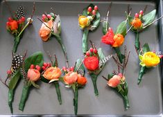My Boutonnieres included: hypericun berries, sticks, ranunculus, feathers an hypericun berries leaves. These were fairly easy to make one we got the hang of it, and if you have several people working as a team, the time goes by quickly
