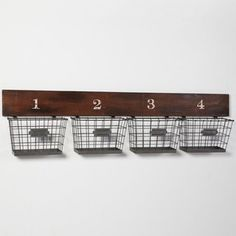 Above washer/dryer @Kathy Kemen   Wood and Wire Wall Multi Basket - eclectic - wall shelves - by PBteen