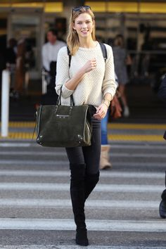 This Is How Karlie Kloss Does Off-Duty #refinery29  http://www.refinery29.com/2015/02/82914/karlie-kloss-best-fashion-week-outfits-2015#slide-5  Karlie hopped off the plane at LAX, both to walk Tom Ford's remote London Fashion Week show and to attend theVanity Fair Oscars after-party.Karlie is wearing Stuart Weitzman boots and a Balenciaga bag. For a similar style, try: