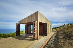 The Moonlight Cabin, designed by Australian architecture firm Jackson Clements Burrows, can transform from a tightly shuttered fortress to an open-air living space in just a few moves. Architecture Awards, Architecture Design, Building Architecture, Cabin Design, House Design, Plan Garage, Movable Walls, Australian Architecture, Passive House
