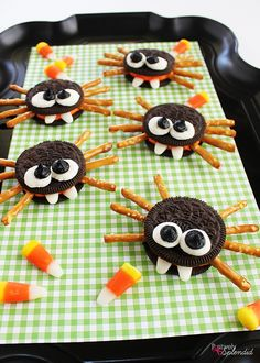 Adorable cookie spiders made with Halloween Oreo sandwich cookies, pretzel sticks, marshmallows and candy corn. An easy food craft for kids.