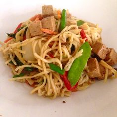 damn delicious veggie tofu noodle stir fry! tofu marinated in ginger, garlic, soy sauce and….coke!!