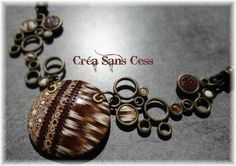 beautiful piece by Crea Sans Cess. I do like the bubbly metal work framing the focal piece