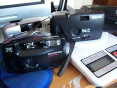 FOUR UNTESTED POINT AND SHOOT CAMERAS.