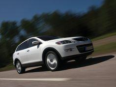 Imagen Angulo Frontal autos SUV Mazda CX9 2009 blanco.jpg