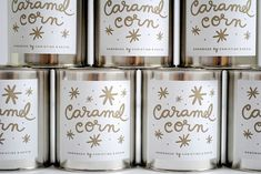 Cute packaging for home-made treats. A metal tin with a white label and gold pen.