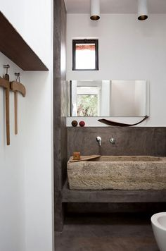 Ancient/Modern House in an Italian Olive Grove A rustic stone sink and vintage wooden hangers : RemodelistaA rustic stone sink and vintage wooden hangers : Remodelista Estilo Interior, Interior Styling, Interior Design, Rustic Stone, Modern Rustic, Vintage Modern, Rustic Cafe, Rustic Logo, Rustic Restaurant