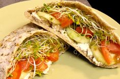 Hummus, pita, cucumber, tomato and sprouts.