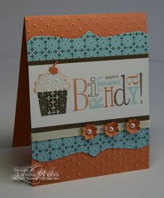 Like the dot-embossed cupcake top and the layout and the blue with the orange-ish color. LW Designs: Spicey Cupcake