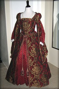 Tudor style Red Gown - quite rich- but whoever thought to tie a drapery cord around the waist of it was wrong, lol.