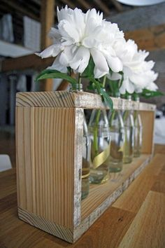 This rustic chic bottle centerpiece is an easy DIY! >> http://www.hgtv.com/shows/danmade/how-tos/how-to-make-a-bottle-centerpiece?soc=pinterest