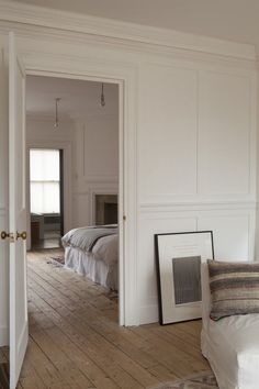 William Smalley flat in Bloomsbury, wood floors, white paneled walls | Remodelista