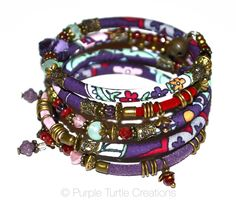 Purple, red, mint and bronze adjustable wrap bracelet with glass, velvet and handmade fabric beads on memory wire by PurpleTurtleStore on Etsy https://www.etsy.com/au/listing/288360763/purple-red-mint-and-bronze-adjustable
