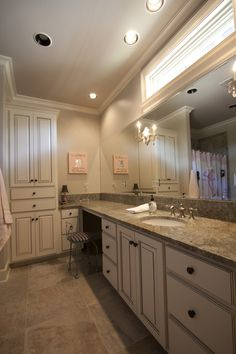 Beautiful Bathroom With Highly Functional Tall Cabinet For Linen Storage.  These Painted And Accented Maple