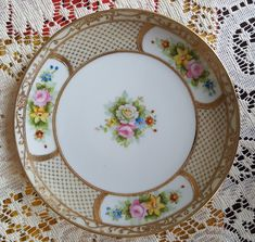Excited to share the latest addition to my #etsy shop: Noritake M, Hand Painted, Collectors 6 1/2 in Plate, Gold Rimmed, Gold Embossed, Yellow, Pink, Blue and Red Flowers and Scrolls, Vintage http://etsy.me/2Dj29DH #housewares #gold #beige #birthday #valentinesday #han