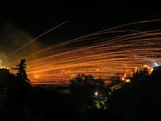 Discover Chios Rocket War in Vrontados, Greece: Two churches shoot bottle rockets at each others' bell towers in an unusual Easter celebration. Chios Greece, Greek Easter, 11th Century, Greek Islands, Greece Travel, Beautiful Islands, My Happy Place, Fireworks, Places To Go