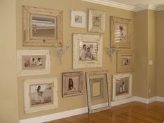 LOVE THIS! the color of walls and white trim and distressed frames. but kinda think I'd like the frames a lil darker or wall. almost blends in too much ??