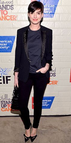 Last Night's Look: Love It or Leave It?   ANNE HATHAWAY   She's really feeling the menswear vibe these days. The actress steps out in a Viktor & Rolf suit featuring black studded lapels at the Hollywood Stands Up to Cancer event.