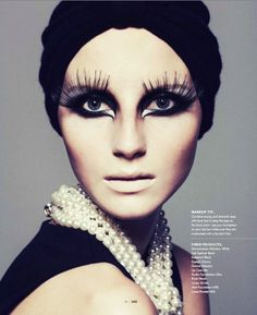 lashes, black liner, pale lips, hat, turban, pearls