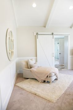 Love this barn door and custom chaise from www.4-chairs.com
