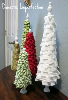 DIY christmas trees out of wooden candle stick, cone styrofoam and leftover fabric so  making these next year