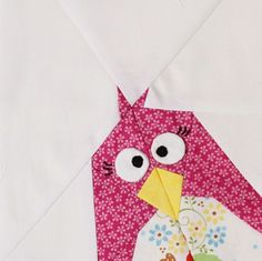 cute! close-up of a pieced pink penguin block for a baby quilt