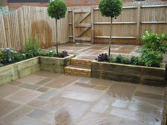 small courtyard garden for entertaining and easy plant maintenance, raised sleeper planting beds, Indian Sandstone paving