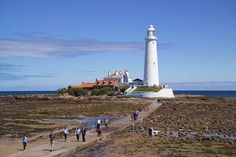 Credit: Richard Klune/Corbis St Mary's lighthouse, north of Whitley Bay in Tyne and Wear, has been decommissioned but is accessible to visit. British Isles Travel, Northumberland England, Lighthouse Keeper, British Seaside, The Guardian, Light In The Dark, Travel Photos, Lighthouses, Dolores Park