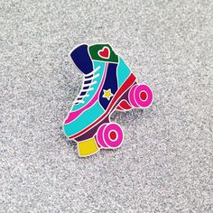 Whether you roller skate at roller discos, the park, skate parks or on the derby track, this pin badge is for you.  Hard enamel pin badge with a matte finish and shiny silver coloured inlay. It has a clutch back and measures 3.2cm x 2.9cm.   P.S. If you like roller derby you should check out these awesome pins we designed for Glasgow Roller Derby: www.glasgowrollerderby.com/merch