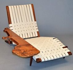 Nakashima's 1961 Long Chair has the wood and clean lines common to midcentury American furniture. Courtesy of Moderne Gallery