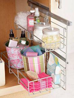 Under bathroom sink storage -- shelf on rails