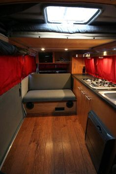 Great T25 interior with clever shelving, curtains pinned at the bottom and pull out larder draws. Gorgeous! From drivenachodrive.com