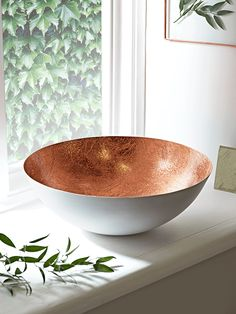 With a soft white outside and a contrasting textured copper colour leaf inside this oversized, light weight bowl makes an eye catching statement on any table top. The perfect size to fill with fruit, it also looks great empty and complements our Copper Interior, Fancy Kitchens, Modern Kitchens, Gadgets, Lounge, Copper Kitchen, Copper Color, Kitchen Accessories, Decorative Bowls