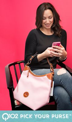 Dooney & Bourke - Large Erica. Go to wkrq.com to find out how to play Q102's Pick Your Purse!