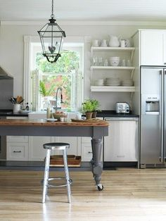 Small kitchen layout, one wall.  Farmhouse table on casters--like the color with the butcher block.: