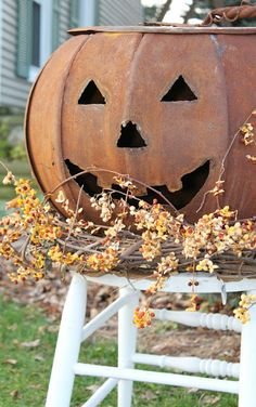Love this jack-o-lantern with the bittersweet..,,love rustic.