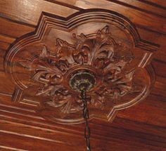 """Ceiling medallions with wood grain? This would be under """"home improvement"""" but I'd do this to make a theatre."""