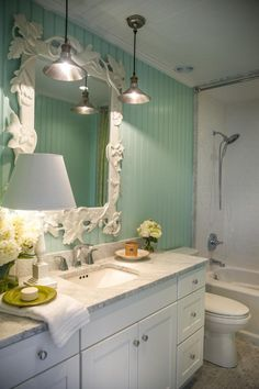 This bathroom is proves that you can use sea green and white in a room without a beach theme