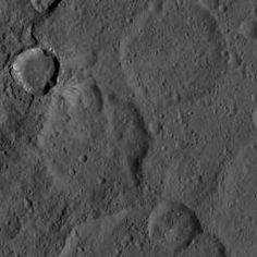 Feast your eyes on an intriguing crater with bright material on its walls.  This image, taken by NASA's Dawn spacecraft, shows a portion of the southern hemisphere of dwarf planet Ceres from an altitude of 915 miles (1,470 kilometers). The image, with a resolution of 450 feet (140 meters) per pixel, was taken on August 21, 2015.