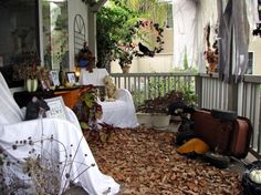 "Dead leaves, busted pumpkins and covered furniture make for that abandoned haunted house feel. Add some candles when the sun goes down, and just like that, your house is transformed to ""the haunted house down the block."""