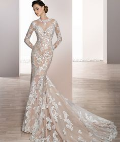 Demetrios 2017 Style 720 Vintage glamour designs this timeless sheath gown with sweetheart neckline over sheer Illusion and long sleeves. Stunning lace embroidery flows from the sheer neckline into low back with buttons and throughout the chapel train. available in white, ivory, white/nude, ivory/nude