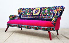 Handmade three seater sofa upholstered with Suzani and velvet fabrics.