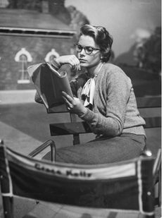 """Actress Grace Kelly studying script for her role of Georgie in """"The Country Girl"""" on the movie set during break in filming. Photo taken by Ed Clark for Life Magazine, 1954.  A director (William Holden) hires an alcoholic has-been (Bing Crosby) and strikes up a stormy relationship with the actor's wife (Grace Kelly in her Oscar-winning role)."""