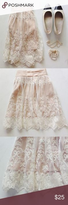 Vintage Lace Tulle Skirt Vintage Lace Tulle Skirt with Bow lace details and lace hem ••• Perfect Condition Size XS ~~~  Gorgeous 100% authentic Vintage skirt.  So pretty and elegant, looks lovely with a simple black turtleneck and heels!   Vegan Friendly  Vintage Skirts