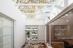 Cotignola Staricco Tobler slots office between warehouses in Montevideo Montevideo, Dezeen, Atrium, Facade, Blinds, Home And Garden, Backyard, Interior Design, Warehouses