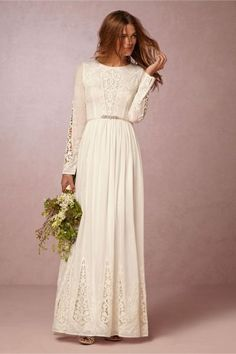Long-sleeved white lace wedding dress from BHLDN.   A Practical Wedding